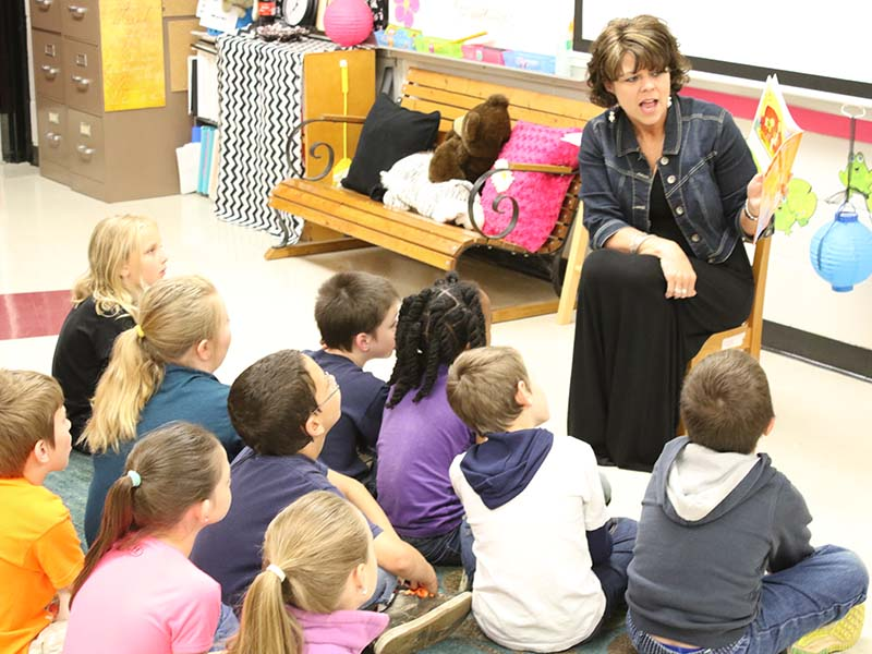 teacher reading outloud to the students